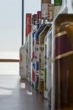 Botellas en una barra Fotos de archivo libres de regalías