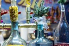 Botellas grandes de mazorca de maíz cerrada del licor imagenes de archivo