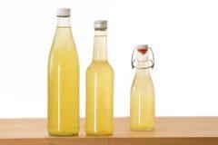 Botellas llenadas del jarabe del elderflower Fotografía de archivo libre de regalías