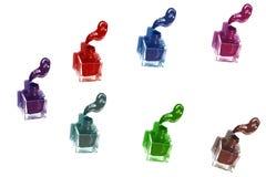 Botellas multicoloras del pulimento de clavo con las salpicaduras foto de archivo libre de regalías