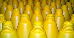 Botellas plásticas amarillas Imágenes de archivo libres de regalías