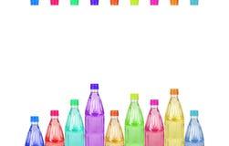 Botellas plásticas coloreadas Fotografía de archivo libre de regalías