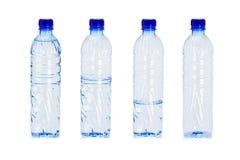 Botellas plásticas con diversos niveles del agua adentro Fotos de archivo libres de regalías