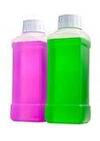 Botellas plásticas con el líquido de la limpieza Imagenes de archivo
