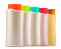 Botellas plásticas de productos del cuidado y de belleza del cuerpo sobre blanco Fotografía de archivo libre de regalías