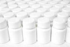 Botellas plásticas en fila Fotografía de archivo libre de regalías
