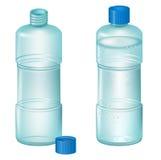 Botellas plásticas transparentes en un fondo blanco. Foto de archivo
