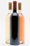 Botellas rojas del vino rosado blanco y Fotografía de archivo