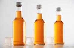 Botellas selladas con la bebida del refresco dentro Foto de archivo libre de regalías