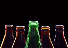 Botellas vacías aisladas en negro fotografía de archivo libre de regalías