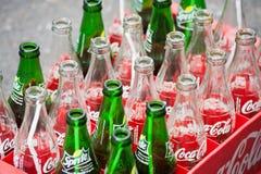 Botellas vacías de Coca-Cola y de sprite Fotografía de archivo
