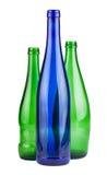 Botellas vacías verdes y azules Imágenes de archivo libres de regalías