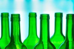 Botellas verdes Fotos de archivo libres de regalías