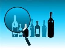 Botellas y lupa Imágenes de archivo libres de regalías