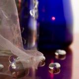 Botellas y piedras Imagen de archivo libre de regalías