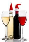 Botellas y vidrios del sombrero rojo de santa del vino blanco Imagenes de archivo