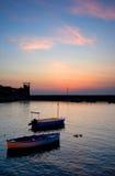 Boten bij zonsondergang Stock Fotografie