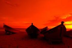 Boten bij Zonsondergang Stock Foto's
