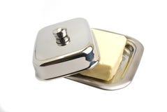 Boter in een metaal boter-schotel Stock Afbeelding