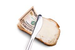 Boter en geld op een boterham Stock Afbeeldingen
