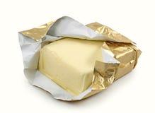 Boter in gouden folie Stock Foto's