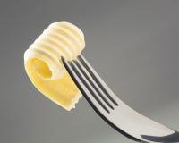 Boter krul op een vork royalty-vrije stock foto