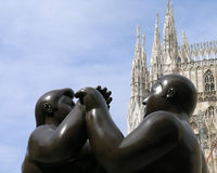 Botero's Dancers in Milan, Italy. Fernando Botero's Dancers brass statues at an open-air street exhibition in Milan, Italy Stock Photos