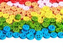 Botões brilhantes coloridos misturados isolados no fundo branco Imagens de Stock