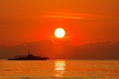 Botes patrulla con salida del sol Imagen de archivo libre de regalías