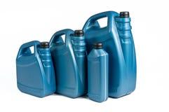 Botes plásticos para el aceite de la máquina Foto de archivo libre de regalías