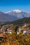 Botev Peak and Kalofer at its foot. Kalofer southern slopes of Stara Planina mountain peak Botev with snow in early autumn Stock Photo