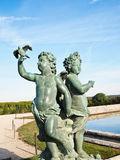 Both Baby and Pigeon Statue. At Versailles castle in France royalty free stock photography