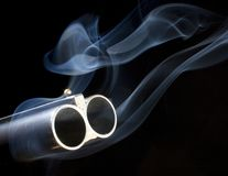 Both barrels blazing Royalty Free Stock Photos