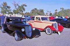 A Nicely Restored Pair Of Ford DEuces. Both the coupe and the pickup truck were built in the early 1930`s during the Depression Era when gangsters like Bonnie stock photography
