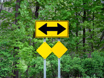 Both Direction Arrow. Street sign of arrows going in both directions with blank small signs below Stock Photos