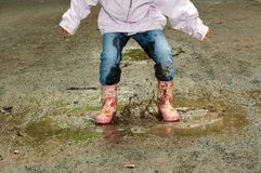Free Both Feet In The Puddle Stock Photos - 3086363