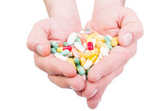 Both hands holding bunch of pills Royalty Free Stock Photography