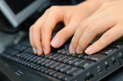 Both hands on keyboard Stock Photo