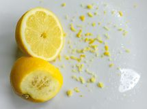 Cut fresh Lemon and peel seen on a dish, ready for a baking ingredient. Stock Photography