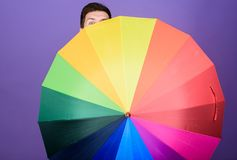 For both rainy and sunny day. Homosexual man holding colorful umbrella. Gay with open folding umbrella. Fashion man with. Colorful accessory. Mens rain gear royalty free stock image