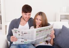 Both read article from newspaper Royalty Free Stock Image