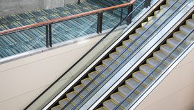 A set of up and down escalators in a public area. royalty free stock photography