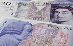 Both side of a twenty. This is a close up of the front & reverse side of a New Twenty Pound Note.This shows the Queen's & Adam Smith's Head Stock Image