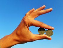 Hand made stag carrying two Anna coins in mouth royalty free stock photo