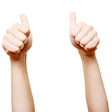 Both thumbs up. Both thumbs pointing high up into the air Stock Photo