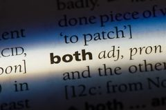Both. Word in a dictionary.  concept stock photos