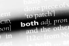Both. Word in a dictionary.  concept stock photo