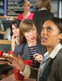 Bothering Coworker at Lunch Royalty Free Stock Image