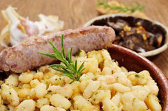 Botifarra amb mongetes, fried white beans and sausage typical of Royalty Free Stock Photos