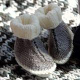 Botines de punto del bebé Fotografía de archivo